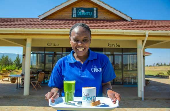 Food server at Ubuntu Café in Kenya. Photo courtesy of G Adventures